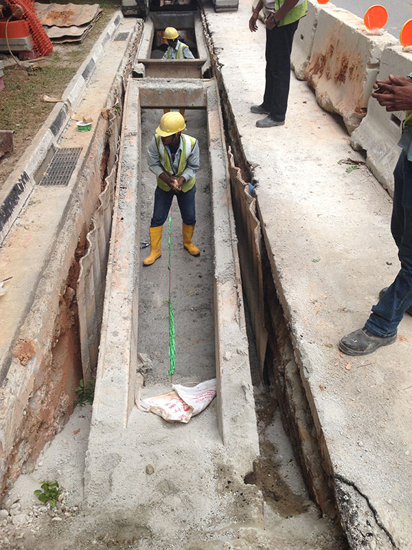 FO cable laying above concrete slabs.